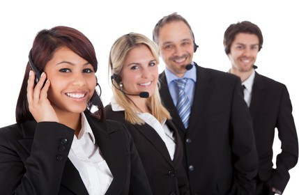 Confident business team with headsets